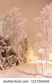 Snowy street outside at winter night