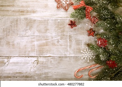 snowy table. festive Christmas background. photo frame, postcard, poster, invitation. happy new year. stylized background. view from the top
