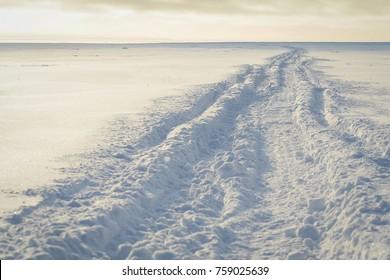 Snowy tundra on Barter Island with the Brooks Range mountain beyond