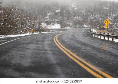 Snowy two lane road in Utah Wasatch Mountains Rocky Mountains along Wasatch Front in Emigration Canyon in Salt Lake City with wet icy snow covered roads