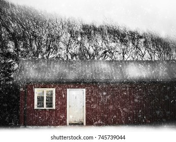 Snowy weather in norwegian countryside, brown red wooden house with white window and door. Larvik, Norway.