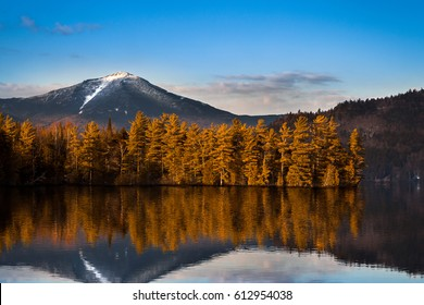 Snowy Whiteface mountain with reflections in Paradox Bay, Lake Placid, Upstate New York - Shutterstock ID 612954038