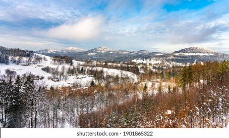 Snowy winter hilly landscape. Beautiful rural range. Panorama with Studenec, Javor and Sokol Hill in Lusatian Mountains, Czech Republic. Black and white image. - Shutterstock ID 1901865322