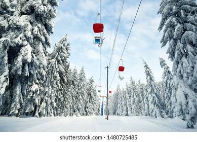 Snowy winter landscape in the National park Sumava, cableway on mount Pancir, Czech Republic.
