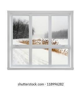 Snowy winter landscape seen through the window.