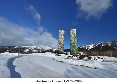 Snowy winter mountain forest scenery and tall buildings