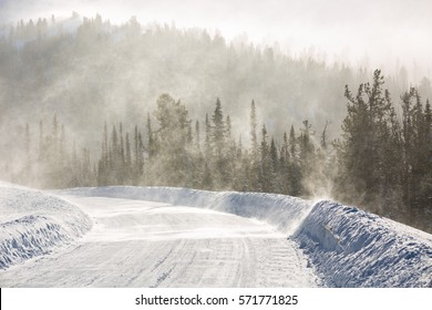 Snowy winter road during blizzard in Russia. Heavy snow storm.