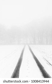 Snowy winter road with fog