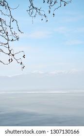 Snowy winter scene on the lake Orestiada in Kastoria ,Greece