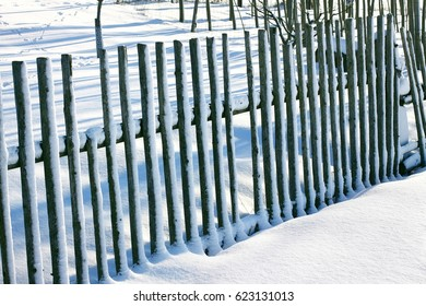 snowy wooden fence
