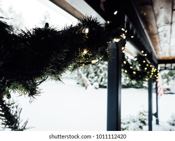 Snowy wreathe with lights outdoors