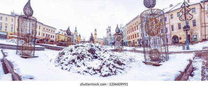 SNP square in Banska Bystrica, Slovak republic. Winter scene. Travel destination. Purple photo filter.