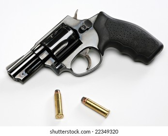 snub-nose revolver with bullets on white background