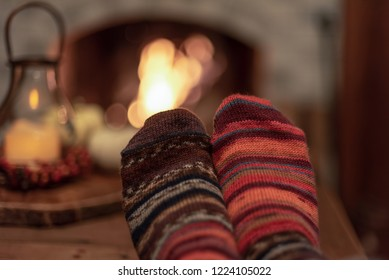 Snuggling up by the fire in cozy handknit wool socks
