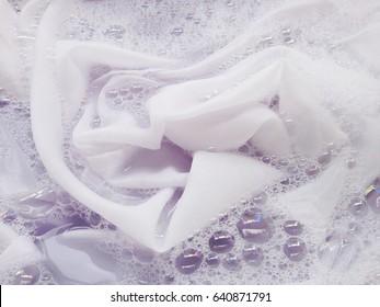 Soak a cloth before washing, white cloth