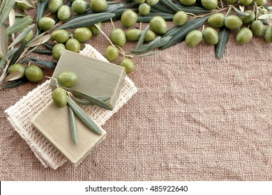 Soap bar with olives <green leaves on burlap