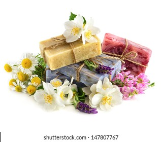 soap bars with fresh lavender, jasmine, clover and chamomile flowers isolated on white background