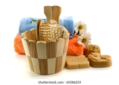 soap and bath accessories on white background