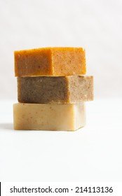 soap blocks on white wooden table, not isolated