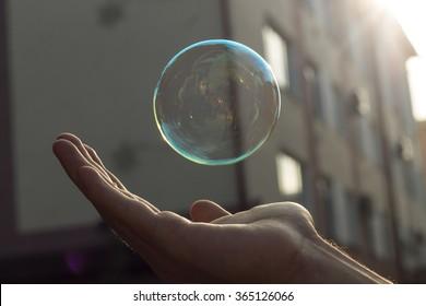 Soap bubble under hand