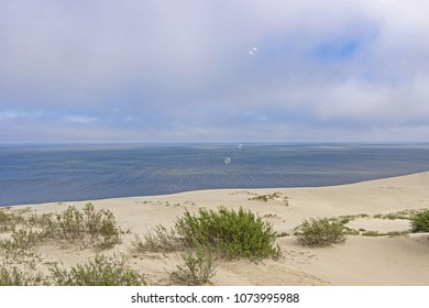 The soap bubbles above the Epha height on the curonian spit. Curonian Lagoon. Windy.  Baltic Dunes. Unesco heritage.