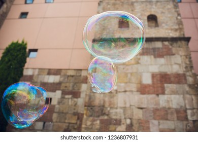 Soap bubbles against the city hall. Barselona.