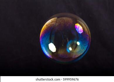 Soap bubbles on a black background