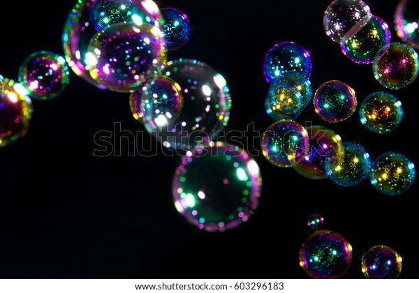 Soap bubbles on black background