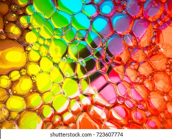 Soap bubbles on a colourful cross-shaped background