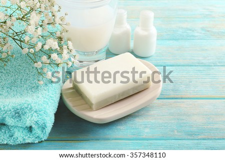 Soap on a dish over wooden background