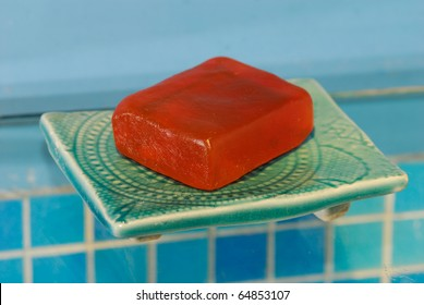 A soap on a soap-dish in a bathroom.