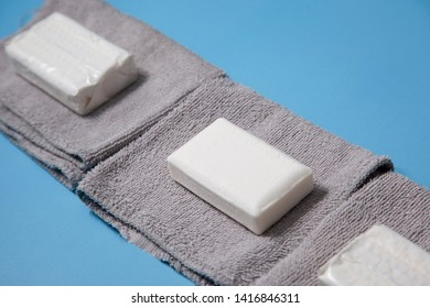Soap and washcloths ready for use against a blue background