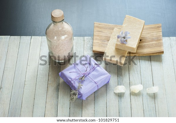 soaps balance and flowers on wooden table