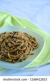 Soba noodle with ginger garlic soy sauce garnish with sesame seeds