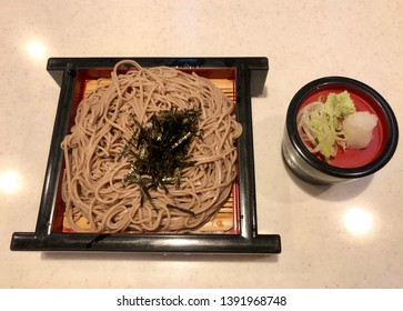 Soba served on a zaru. Soba is a type of thin Japanese noodle. It is made from buckwheat flour.