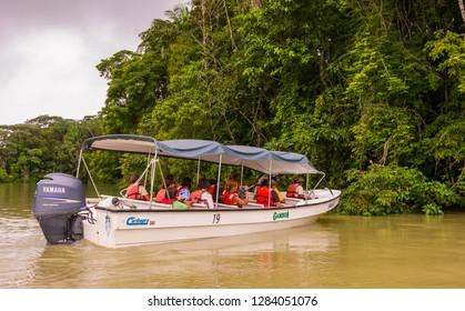 SOBERANIA NATIONAL PARK, PANAMA - AUGUST 14, 2009: Ecotourists during boat tour of Gatun Lake.