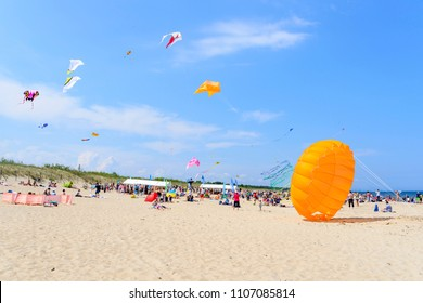SOBIESZEWO - MAY 27: Tourists enjoy the sunny weather on the Baltic sea beach during the Kite Festival on 27 May 2018 in Sobieszewo, Poland.
