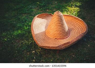 Sobrero hat on the grass as Mexican symbol. Cinco de Mayo concept