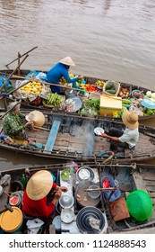 Soc Trang, Vietnam - April 5, 2018: Buying and selling agricultural products on Mekong River.Boat women sell fruit, flowers, agricultural products on floating market in Soc Trang, Vietnam