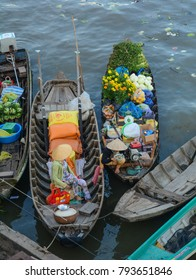 Soc Trang, Vietnam - Feb 2, 2016. Wooden boats at market on Mekong River in Soc Trang, Vietnam. Mekong is the world 12th-longest river and the 7th-longest in Asia.