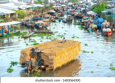 Soc Trang, Vietnam - January 30th, 2019: Buying and selling agricultural products on river crowded with boats fruit, flowers, agricultural products on busiest floating market in Soc Trang, Vietnam