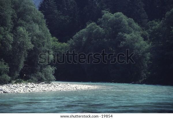 Soca River Flowing through Forest Slovenia