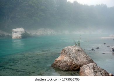 Soca river in the summer morning; Soca is an Alpine river with source in Trenta valley in Slovenia; it is famous for its emerald-green water, cleanliness, local genre of trout,metal camp festival etc.