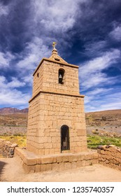 Socaire old stone church tower, historic arquitecture buildings in the middle of Atacama Desert, tradition and amazing scenery is what we can see in the heart of the Atacama Desert