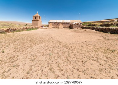 Socaire old stone church tower, historic arquitecture buildings in the middle of Atacama Desert, tradition and amazing scenery is what we can see in the heart of Andes mountains at the Altiplano