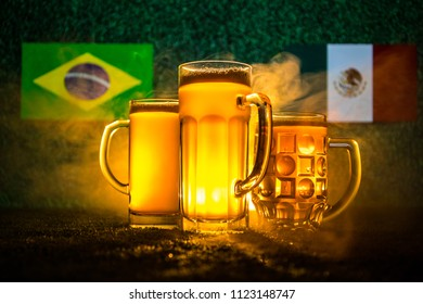 Soccer 2018. Creative concept. Beer glasses on grass. Support your country with beer concept. Selective focus