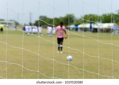Soccer action Penalty Shootout focus net and blur player