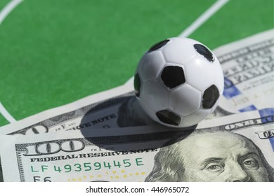 soccer ball and dollars on the football field