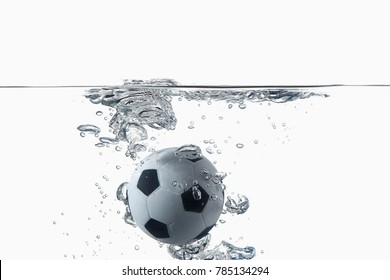 Soccer ball drop and splash into water