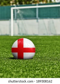 Soccer Ball with England Flag on the grass in stadium